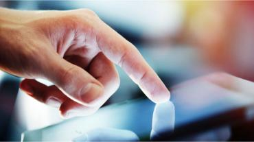businessman hand touching digital tablet © peshkova - Fotolia.com