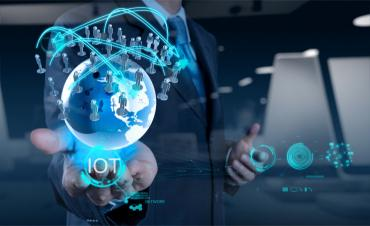 Business man hand holding IoT world and workforce © everythingpossible - Fotolia.com