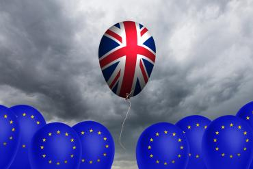 UK flag Brexit stormclouds from EU balloons below © meatbull - Fotolia.com