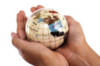 World globe in cupped hands © snowwhiteimages - Fotolia.com