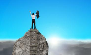 Business man cheering on top of rock mountain with sunrise © Tsung-Lin Wu - Fotolia.com