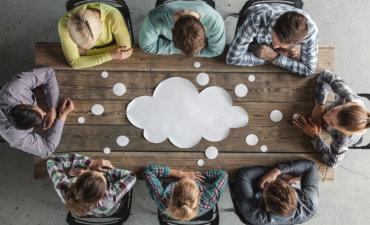 Teamwork meeting at table with cloud thought bubble © alotofpeople - Fotolia.com