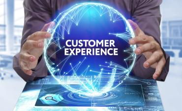 Customer experience hands on digital globe © photon_photo - Fotolia.com