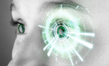 Eye of a woman with digital interface in front © Production Perig - Fotolia.com