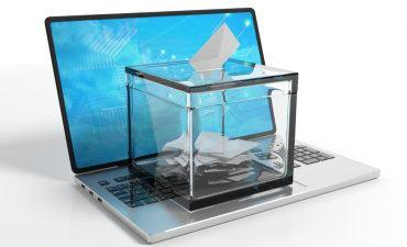 Transparent ballot box on laptop © Rawf8 - Fotolia.com