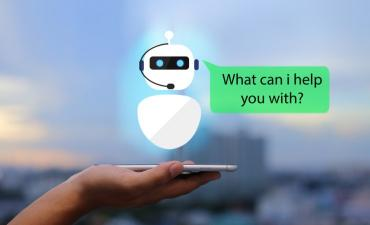 AI chatbot customer experience smartphone in hand urban © panuwat phimpha - shutterstock