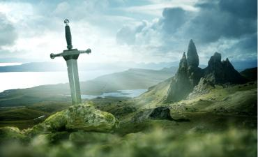 Ancient sword of truth in rugged quest landscape © solarseven - shutterstock