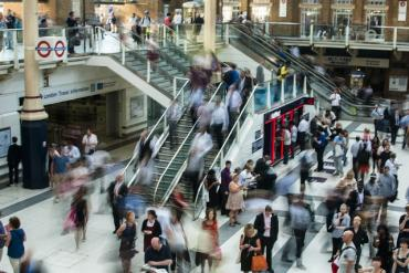 An image of Liverpool Street Station and a busy crowd