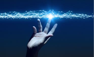Hand reaching up to touch mesh network on blue background © metamorworks - shutterstock