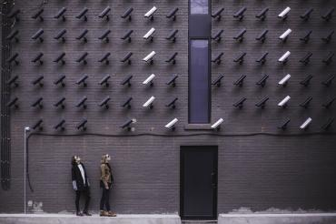 Image of cameras looking at people on the street
