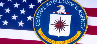Image of the American flag and CIA logo
