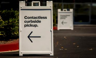 Contactless curbside pickup sign in retail store parking lot © F Armstrong Photography - shutterstock