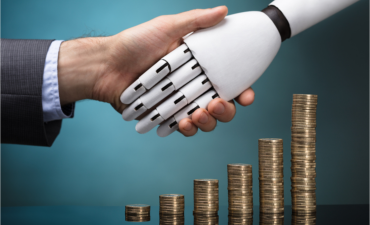 Human and robot shaking hands over stacked coins AI finance trust concept © Andrey_Popov - Shutterstock