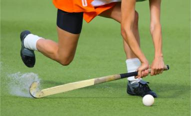 Man playing field hockey. High speed.