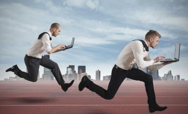 Two businessmen race with laptops in competition - © alphaspirit - Fotolia.com