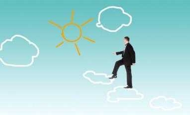 Business man stepping on clouds towards sun outline © red150770 - Fotolia.com