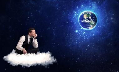 Business man sitting on cloud looking at planet earth © ra2 studio