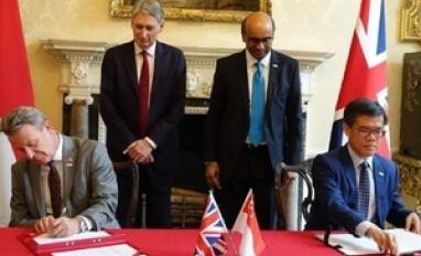 Image of GDS and Singapore GovTech signing MoU