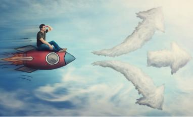 Man on rocket choosing between up, level or down cloud arrows © StunningArt - shutterstock