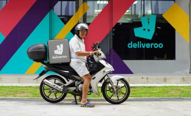Deliveroo delivery rider outside Editions kitchen