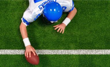 Overhead American football player making a one handed touchdown © RTimages - shutterstock