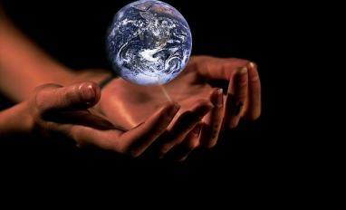 Image of someone holding the world in their hands