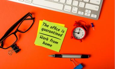 Post-it note on orange desk saying office is quarantined, work from home © Bychykhin Olexandr - shutterstock