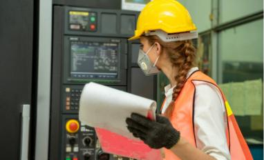 Female technician checks machine wearing protective mask against Covid-19 © M2020 - shutterstock