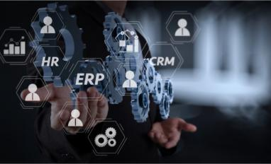 Architecture of ERP system with connections and hand showing gear to success concept © everything possible - Shutterstock
