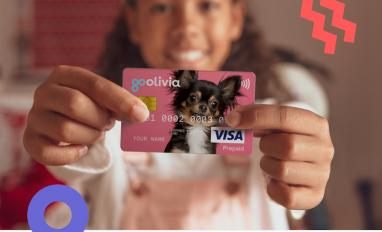 Image of a child holding a gohenry debit card