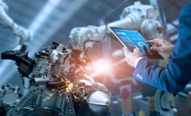 Operator checks automated robot in digital manufacturing © PopTika - shutterstock