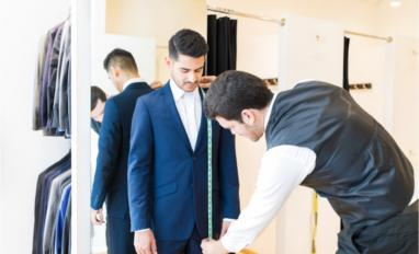 Fashion designer taking measurement of man wearing suit in tailor shop © antoniodiaz - Shutterstock