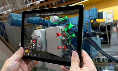 Augmented reality concept. Hand holding tablet with AR service technician in smart factory background © Zapp2Photo - Shutterstock