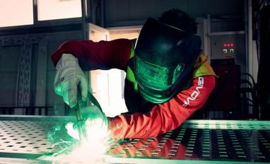Image of someone working in manufacturing