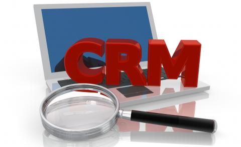 CRM Laptop with magnifier glass