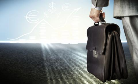 Businessman hand carrying briefcase facing horizon with currency signs © Sergey Nivens - Fotolia.com