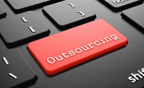 Outsourcing on Red Keyboard Button. tashatuvango - Fotolia