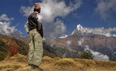 Nepali man, mountain and clouds © gringos - Fotolia.com