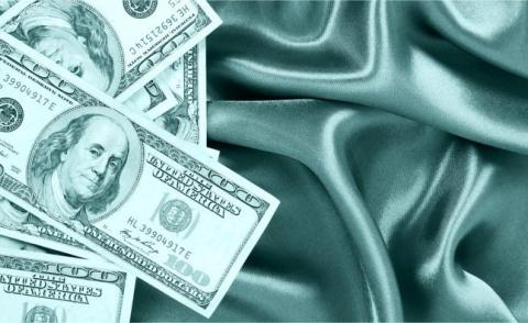 Dollar bills on gray silk sheets © Guzel Studio - Fotolia.com