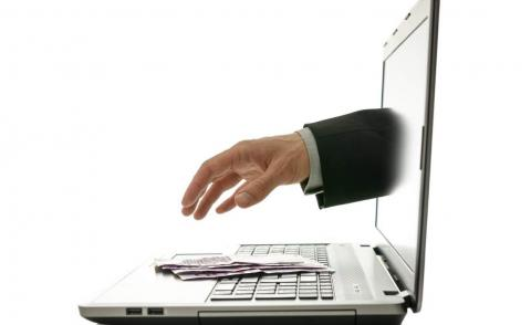 man sticking hand from laptop