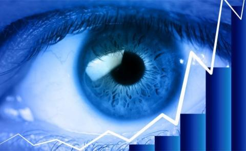 Eye in blue close-up with finance concept © Daniele Depascale - Fotolia.com
