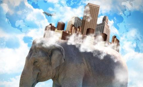 Elephant carrying city on back with clouds © HaywireMedia - Fotolia.com
