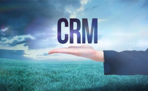 Business woman hand presenting word CRM with grass, cloudy sky background © WavebreakMediaMicro - Fotolia.com