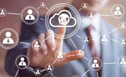 Businessman behind touch interface cloud people network © maxsim - Fotolia.com