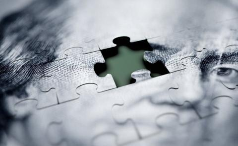 Money puzzle based on US dollar bill © bartsadowski - Fotolia.com