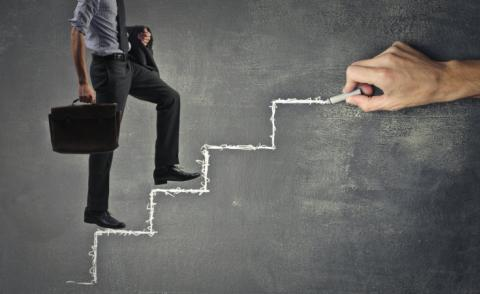 Business man ascending chalk steps drawn on board © olly - Fotolia.com