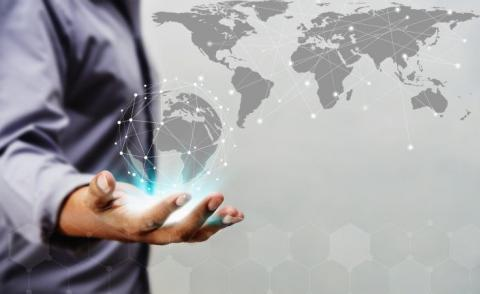 Businessman holds tech circle over world map © jimbophotoart - Fotolia.com