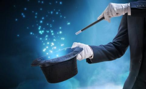 Magician wand and hat with stars on blue © vchalup - Fotolia.com