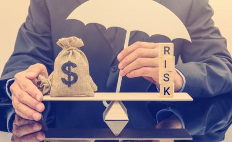 Business man balancing cost and risk © William Potter - shutterstock