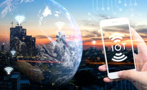 Hand holding white phone and IoT icon with city sunset and earth furnished by NASA © Zapp2Photo - shutterstock